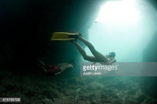 Couple Snorkeling, Skin Diving Underwater Sea Cave