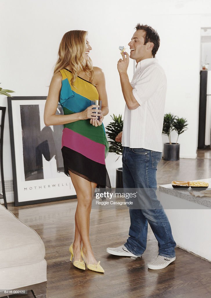 Couple Socializing at Party : Stock Photo
