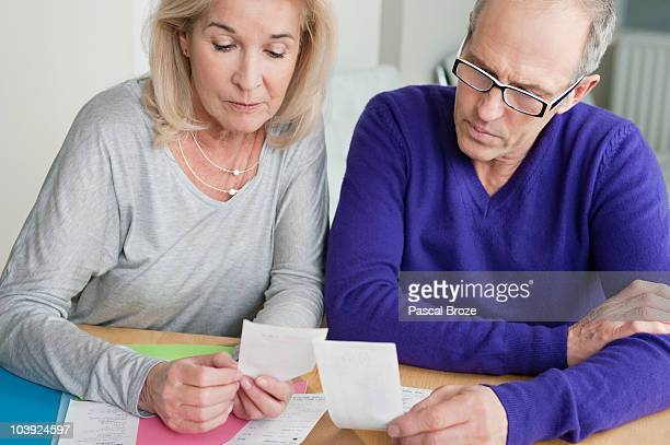Couple sorting out bills