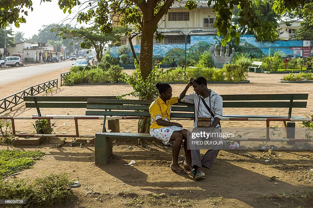 A couple speaks in a park in the centre of Bangui, Central African Republic, on February 13, 2014, on the eve of Saint Valentine's day, amid an ongoing crisis in the country. The impoverished Christian-majority country descended into chaos in March 2013 after a coup by the mainly-Muslim Seleka rebellion overthrew the government, sparking deadly violence that has uprooted a million people out of a population of 4.6 million.