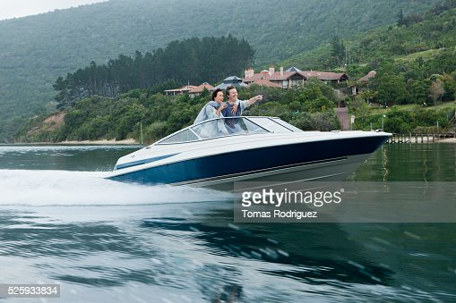Couple speeding on motorboat : Stock Photo