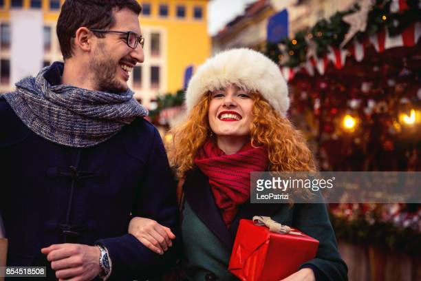 Couple spending holidays and having fun in a Christmas Market