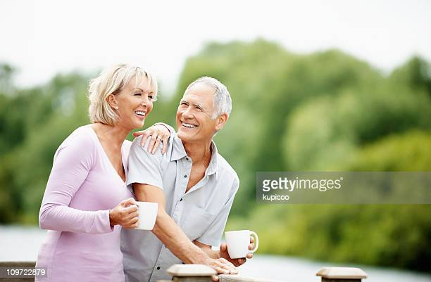 Couple spending time together, holding cup of tea or coffee