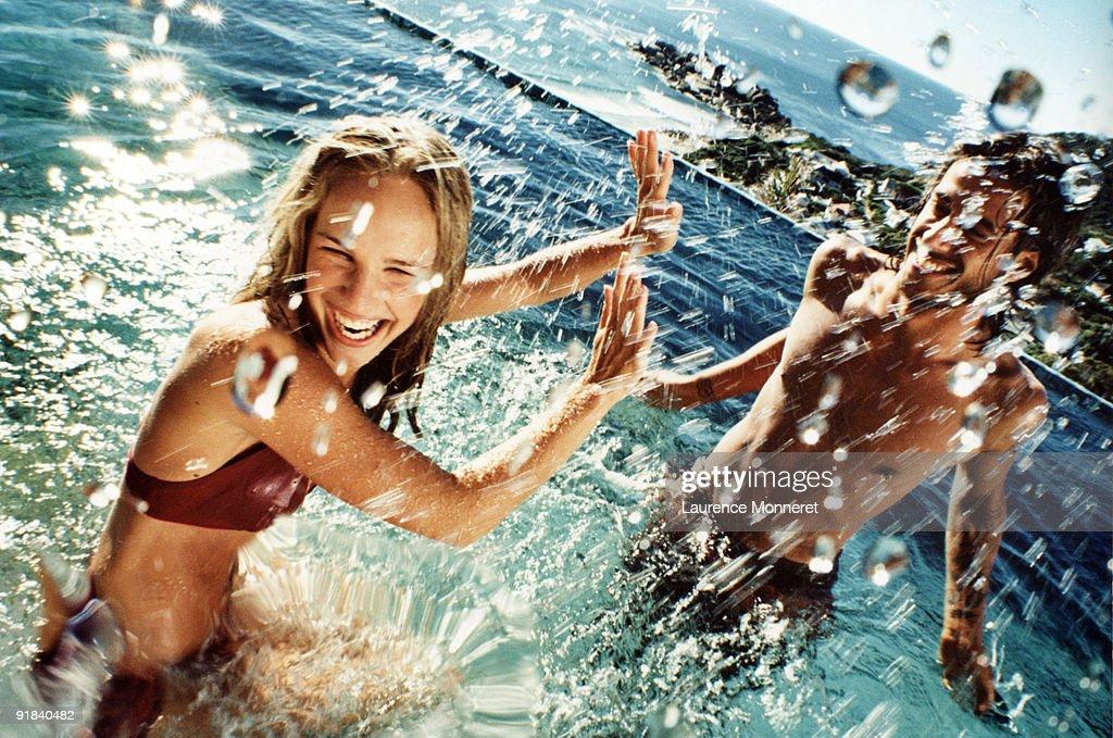 Couple splashing water : Stock Photo