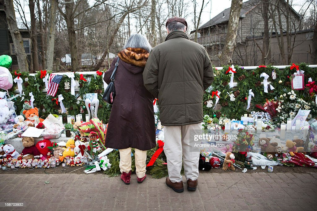 A couple stand in silence a memorial for those killed in the school shooting at Sandy Hook Elementary School, on December 24, 2012 in Newtown, Connecticut. Donations and letters are pouring in from across the country as the town tries to recover from the massacre.
