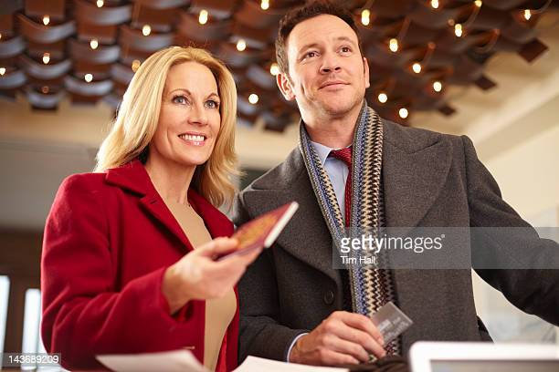 Couple standing at hotel front desk