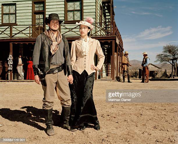 Couple standing at old west town