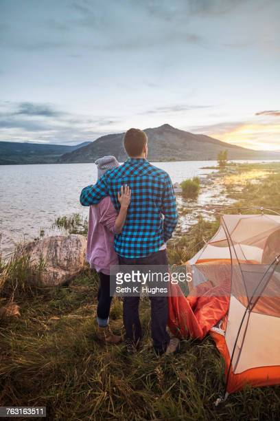 Couple standing beside tent, looking at view, Heeney, Colorado, United States