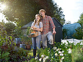 Couple standing in allotment