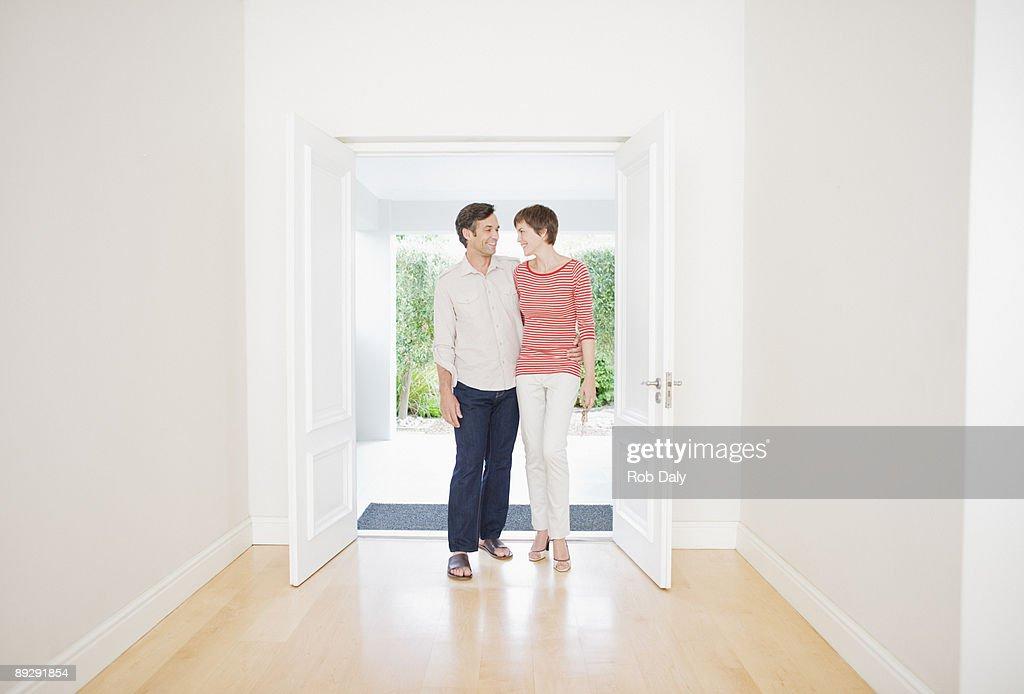 Couple standing in doorway : Stock Photo