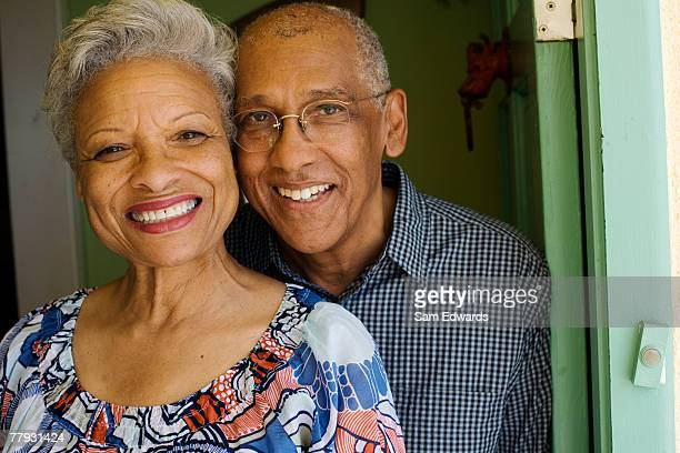 Couple standing in doorway smiling