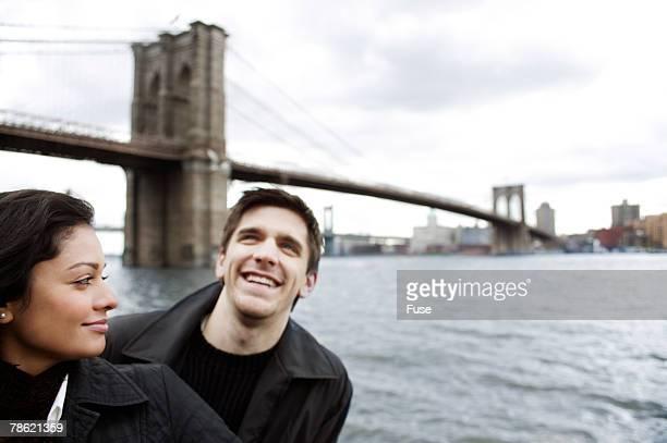Couple Standing in Front of Brooklyn Bridge