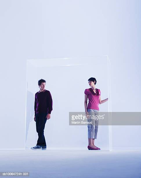 Couple standing in glass cabinet