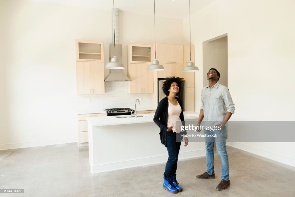 Couple standing in kitchen in new house