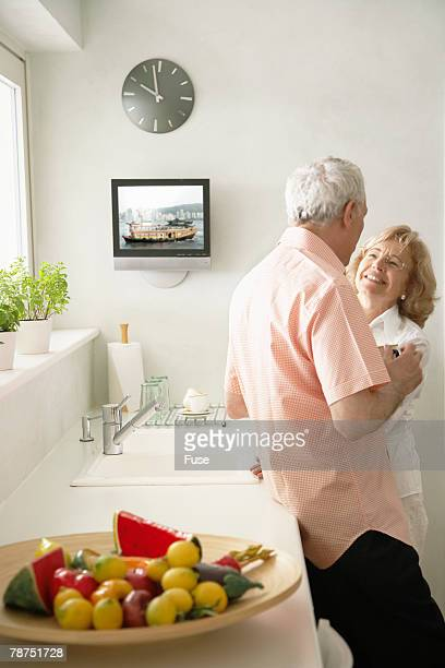 Couple Standing in Their Kitchen