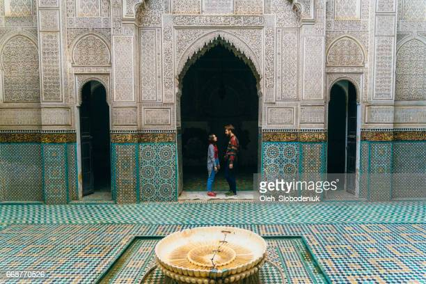Couple standing inside riad in Morocco