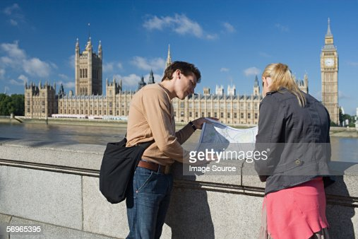 Couple standing near Houses of Parliament