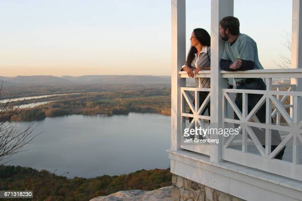 A couple standing on a balcony at Gorham's Bluff Bed and Breakfast looking at Tennessee River