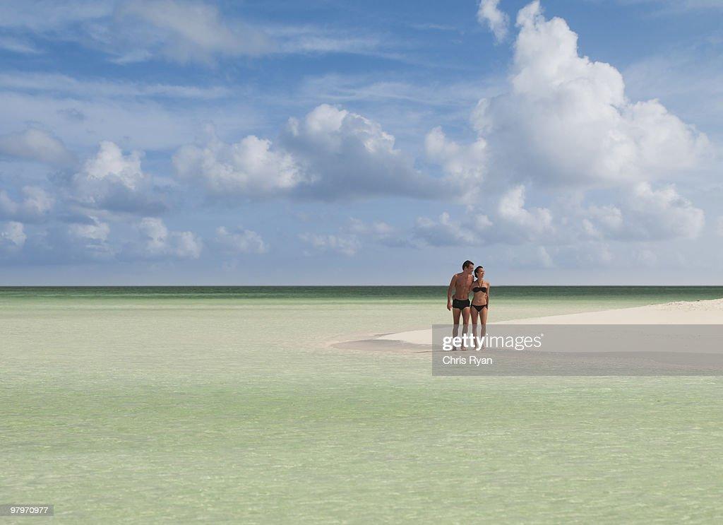 Couple standing on beach : Stock Photo