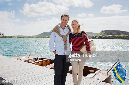 Couple standing on jetty : Stock-Foto