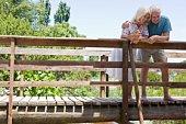Couple standing on rural bridge