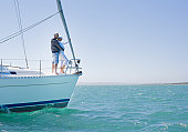 Couple standing on sailboat