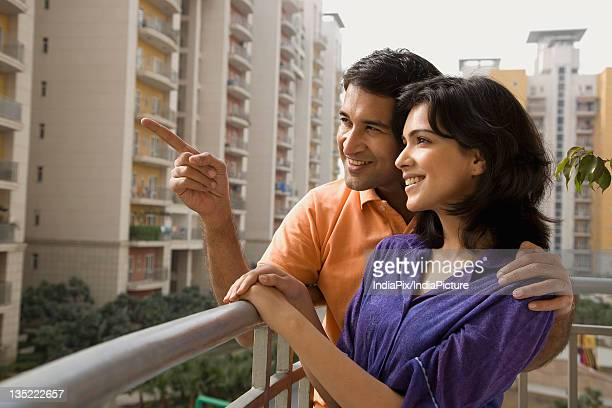 Couple standing on the balcony
