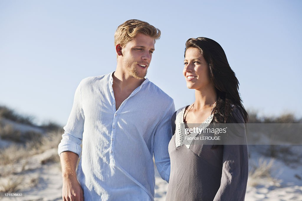 Couple standing on the beach : Stock Photo