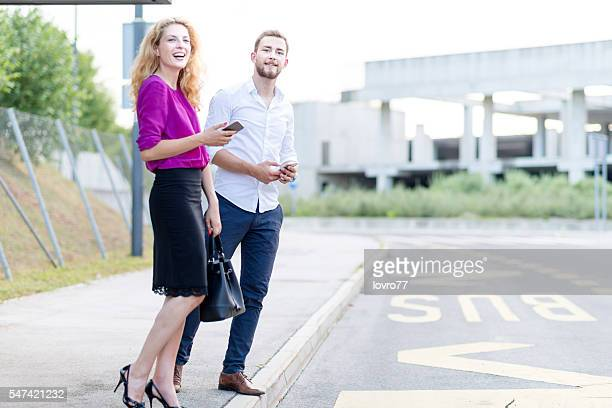 Couple standing on the bus station
