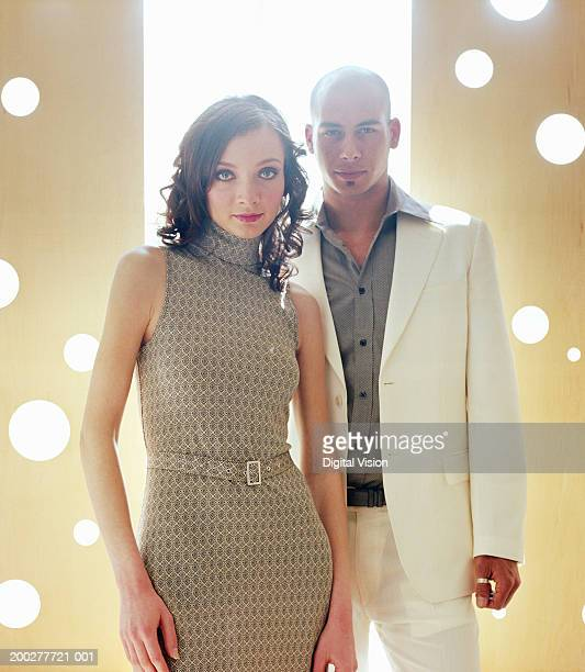 Couple standing side by side, portrait
