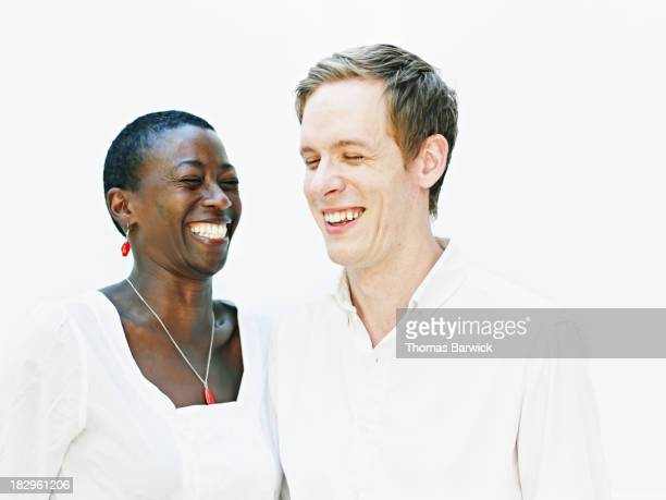 Couple standing smiling and laughing