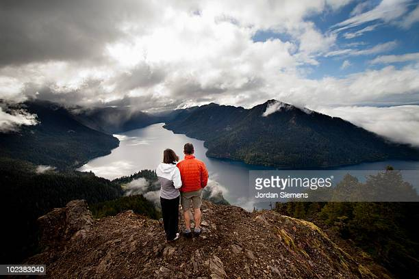 A couple standing the edge of a cliff.