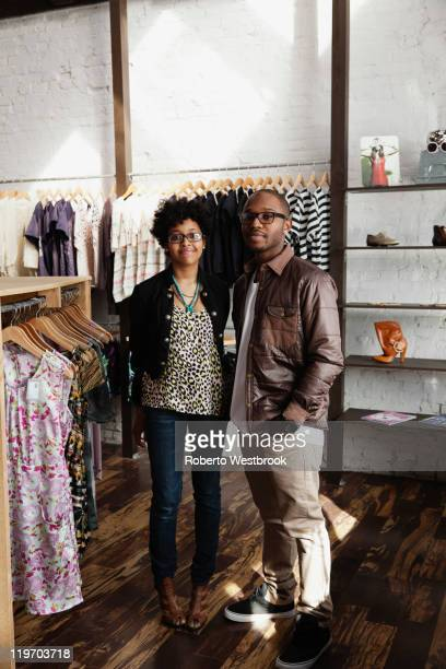 Couple standing together in clothing store