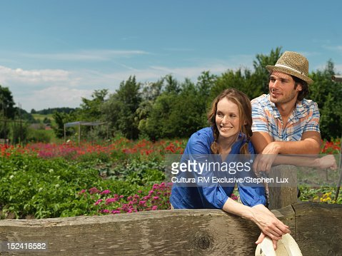 Couple standing together in garden : Stock Photo