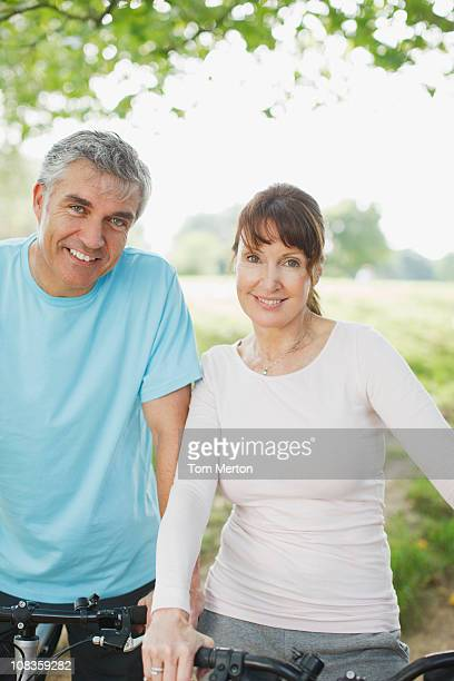 Couple standing together with bicycles