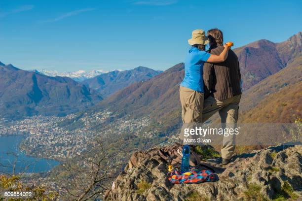 Couple Standing up Together and Enjoying the Mountain View