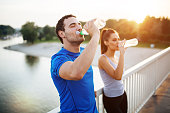 Couple staying hydrated after workout