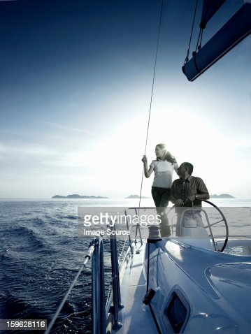 Couple steering a yacht