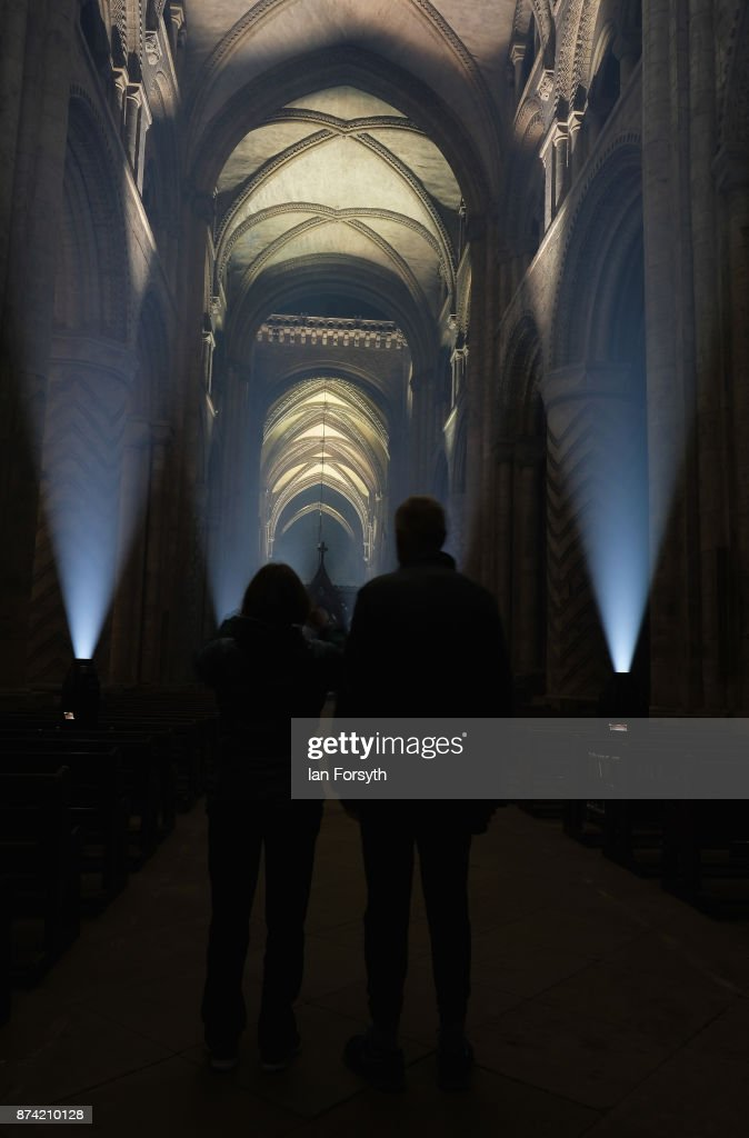 A couple stop to take a picture as the inside of the historic Durham Cathedral is illuminated by a light installation titled 'Methods' by artist Pablo Valbuena during a media preview evening ahead of the Durham Lumiere event on November 14, 2017 in Durham, England. The installation was inspired by the tradition of English change ringing. The Lumiere light festival is the UK's largest light festival and comes to the City of Durham for the fifth time bringing large scale projections and light installations across the city to landmark locations.