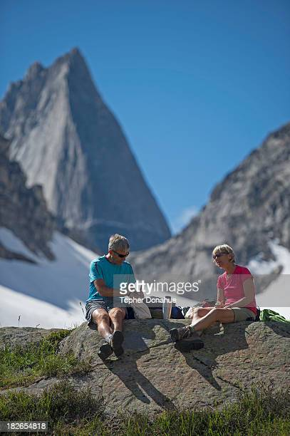 Couple stops for lunch under a huge granite mountain.