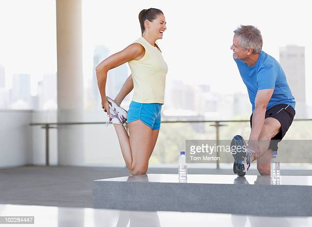 Couple stretching before exercise