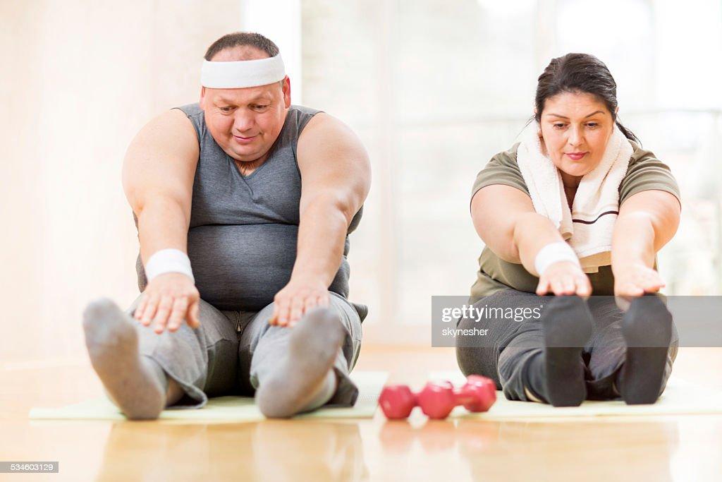 Couple stretching. : Stock Photo