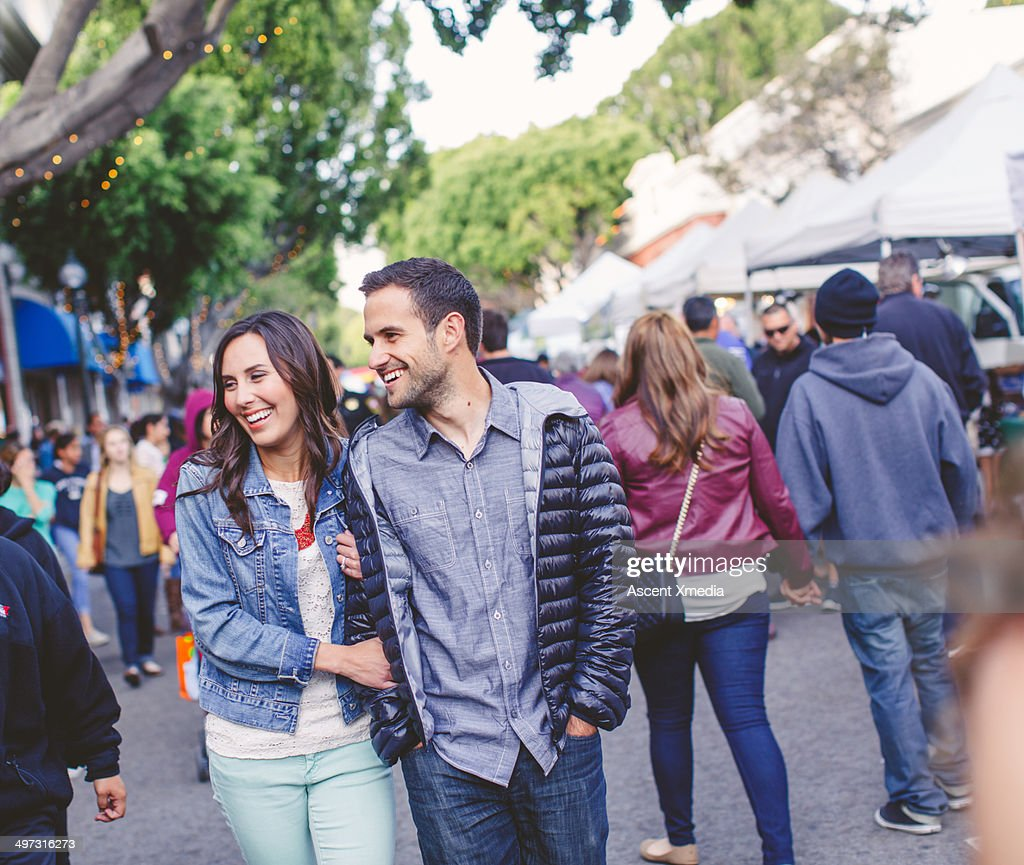 Couple stroll through outdoor market