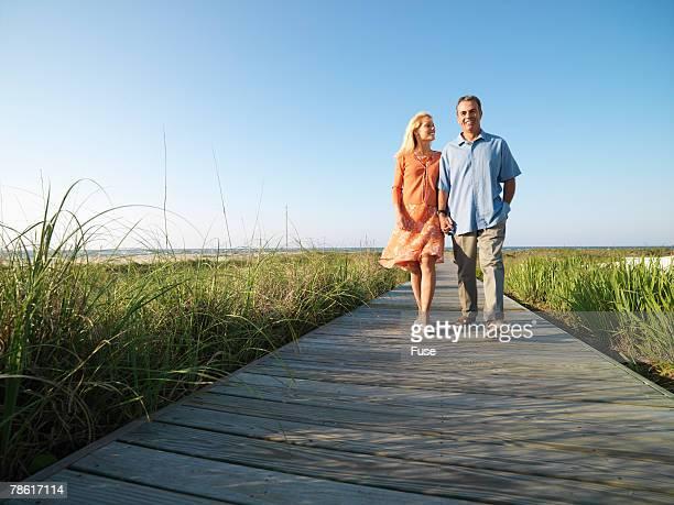 Couple Strolling on Boardwalk