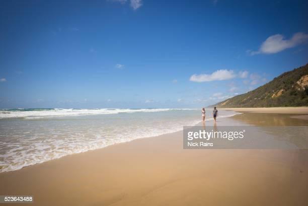 Couple strolling on Teewah Beach