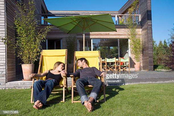 Couple sunbathing on loungers
