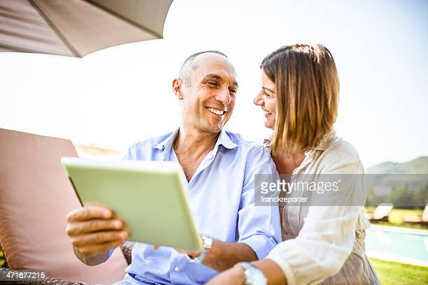 couple surfing on the web at resort