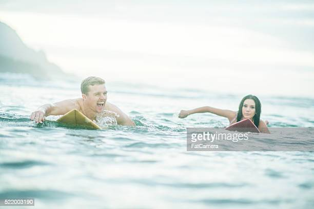 Couple Surfing on Vacation