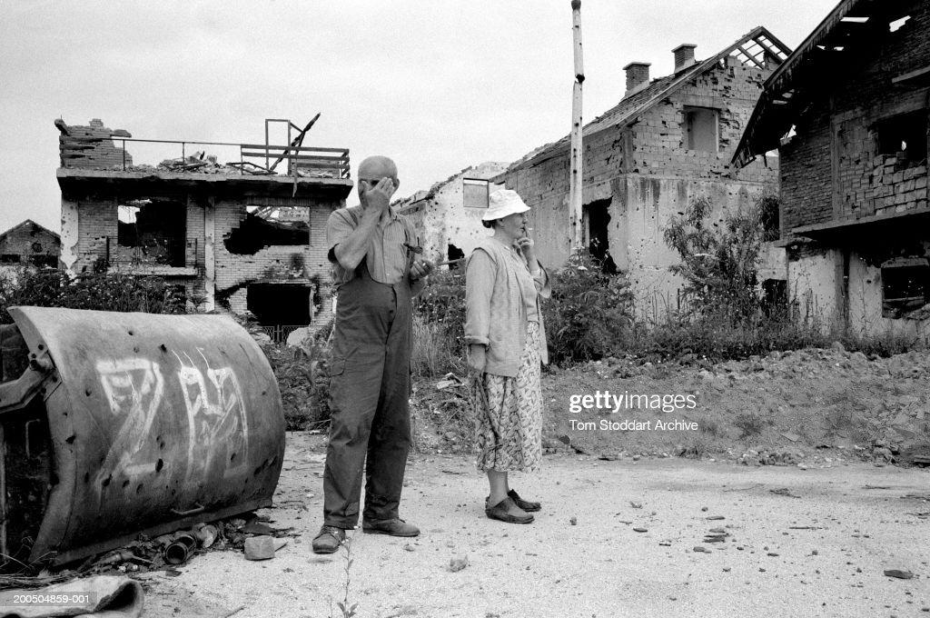 Bosnia Sarajevo April 1996 A couple survey the devastation of their neighbourhood near Sarajevo airport where intense shelling and fighting had...