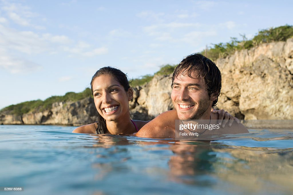 Couple swimming in sea : Stock Photo